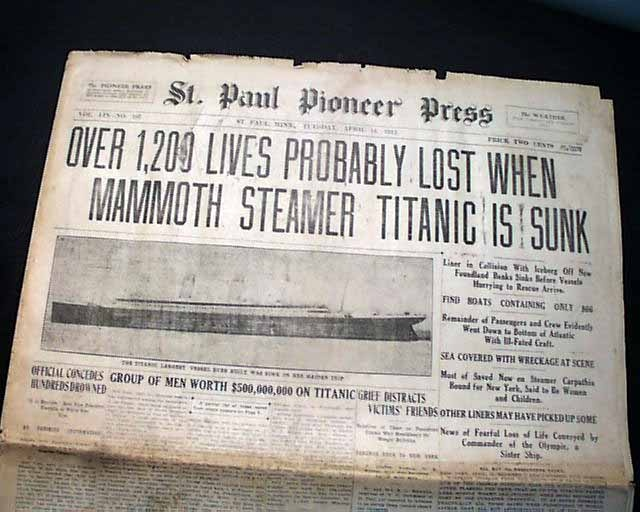 """Historic Newspaper with dramatic headline covering the Titanic disaster:  """"OVER 1,200 LIVES PROBABLY LOST WHEN MAMMOTH STEAMER TITANIC IS SUNK""""."""