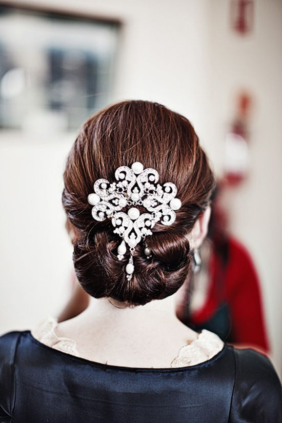Pretty. :) The accessory is a bit... too big for my taste, but I love the simplicity of the hair style.