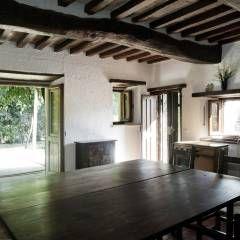 Salas de jantar rústicas por Archenjoy - Studio di Architettura -