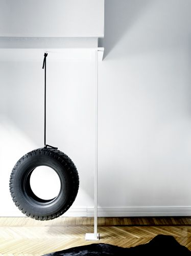 Functional or Art? Either way, I love the tire swing in this modern home.