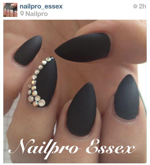 Matte black nails. the almond shape.