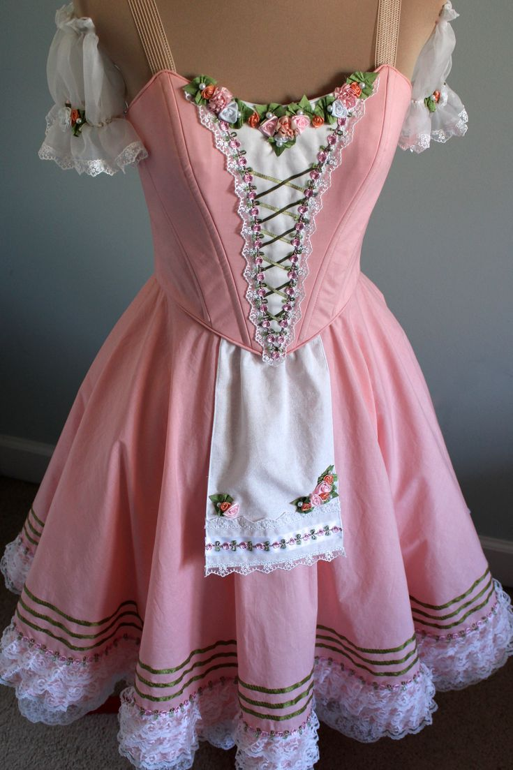 Swanilda, DQ DESIGNS tutus and more-- pink is good, crosses in front, lace, sleeves, flowers