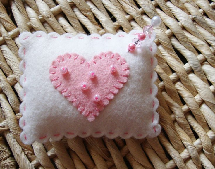 Wool Felt Pin Cushion; what an awesome and quick present this would make for someone who crafts; just use a sizzix die (such as scalloped square) for main body of the cushion, then another die such as a flower or heart for embellishments (and stitch on with a blanket stitch)
