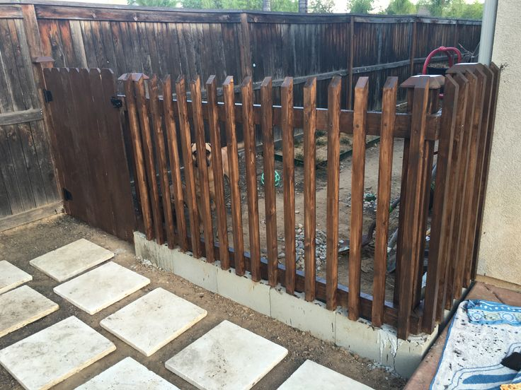 Cinder block and wood fence for dog run / side yard