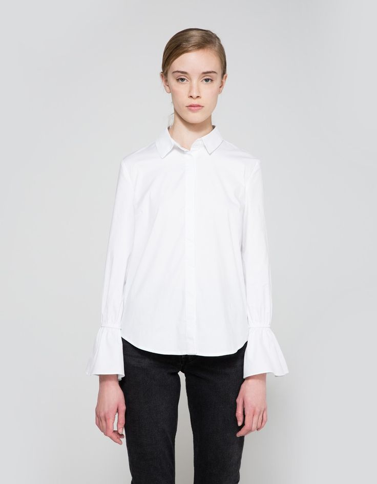 Stylized button-down in White. Pointed collar. Concealed full button placket. Straight back yoke with center box pleat detail. Long sleeves with circular flounce detail at elasticized cuff. Shirt hem.   • Stretch oxford • 97% cotton, 3% spandex • Hand