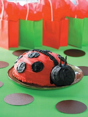 Ladybug cake. This one would benefit from a bit of finessing, including cute eyeballs and actual wire antennae (sold at Michael's). I'm thinking cupcakes for the kid party, and one big cake for the grown-up one with family. And if you're wondering how to get the cake domed like that - you bake it in a metal mixing bowl! =)