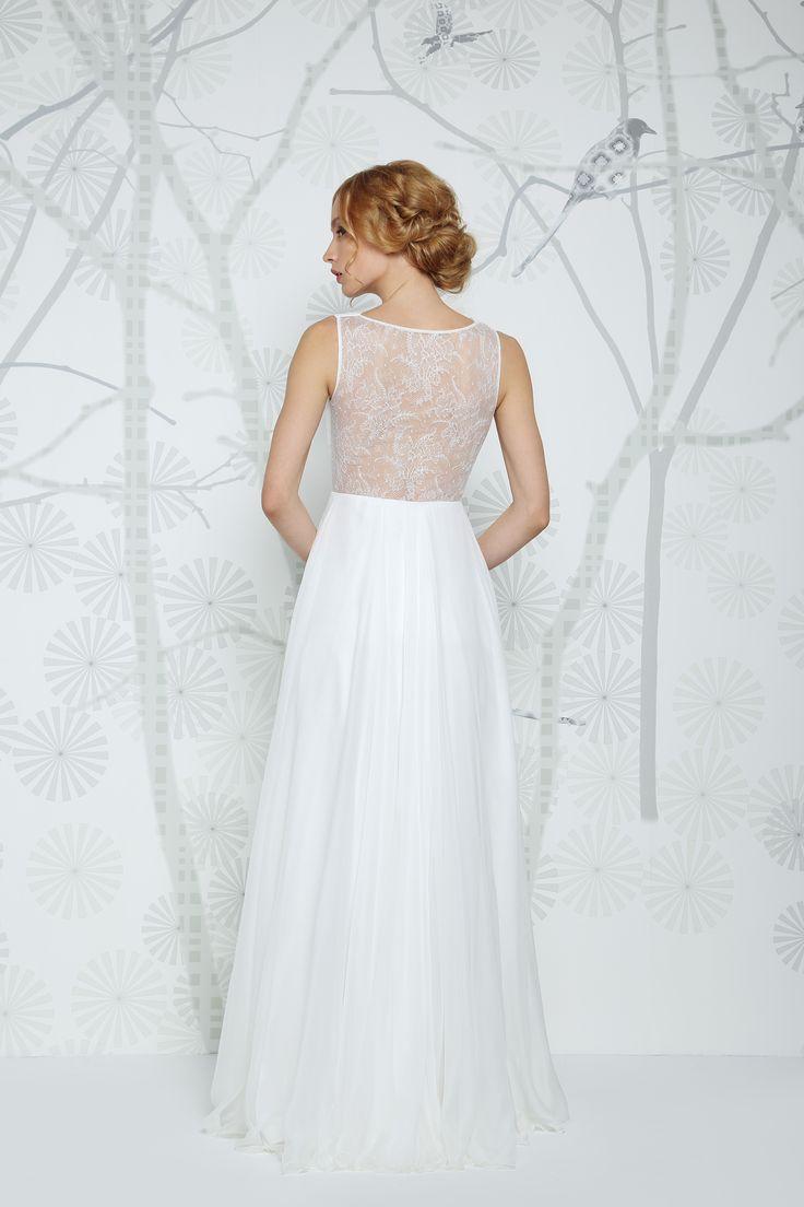 SADONI wedding dress ENIMA with flattering v-neckline, covered French lace back, and flowy chiffon skirt. Romantic waistline flower details.
