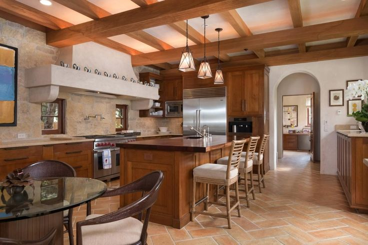 Southwestern Kitchen with Kitchen island, Custom hood, Flush, herringbone tile floors, Limestone counters, Slate Tile