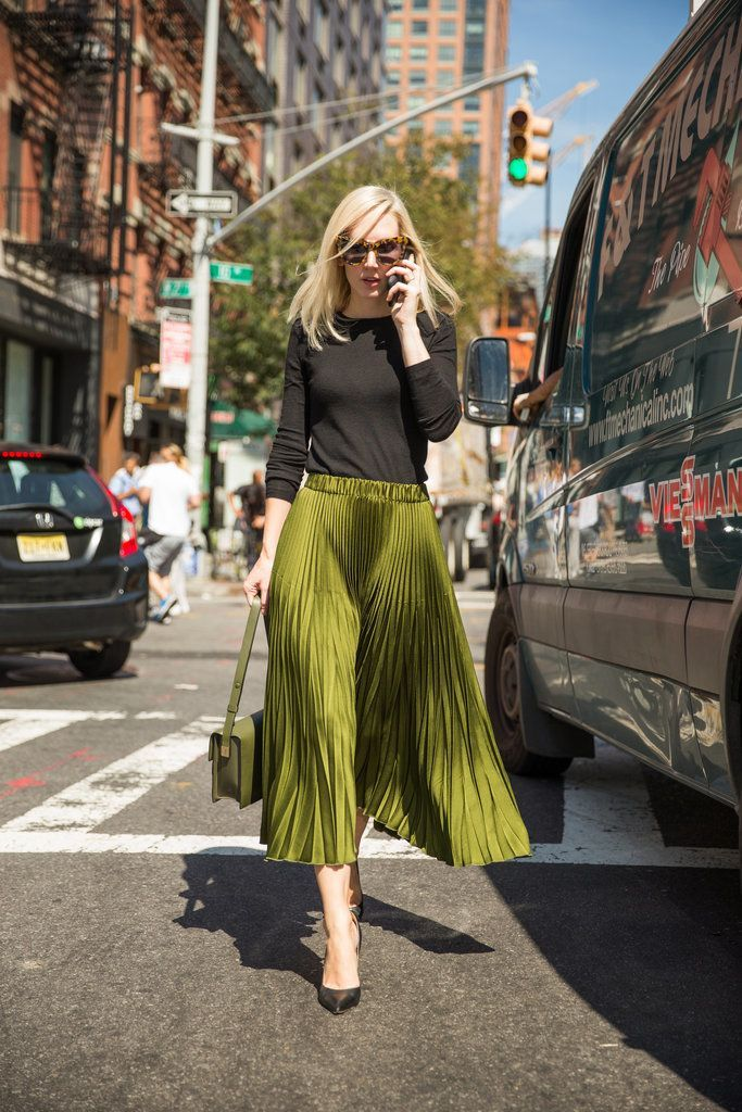 A full pleated skirt paired with a black knit top.