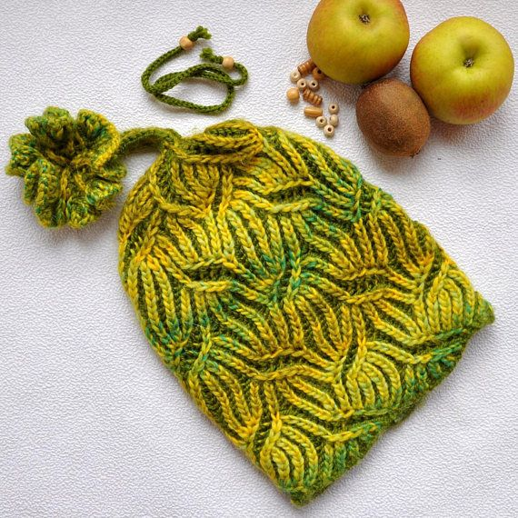 Brioche stitch. Womens Knit Cap. Winter hat hand made.  2 color brioche knitting. Hat knitted wool. Yarn Pekhorka (wool 50% and acrylic 50%). Yarn roving. No seams. One size fits most. Colors: green, yellow. When using this hat: Hand wash (35°C) Ready to ship.