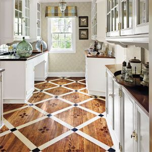 Use tape, paint, and a stencil to make this classic floor pattern shine.