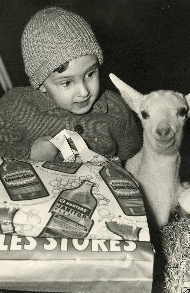 A young girl with showbags at the Royal Melbourne Show. Picture: RASV Heritage Collection