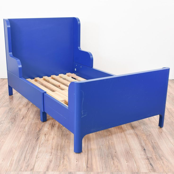 This twin sized bed frame is featured in a wood painted in a dark blue paint. This bed frame has some wear but is otherwise in great condition with a tall headboard, curved sides and an adjustable length. Perfect for a kids bedroom!   #eclectic #beds #bedframe #sandiegovintage #vintagefurniture