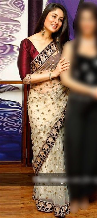 Kareena wore a nude net Manish Malhotra sari when she unveiled her wax statute at Madame Tussauds.