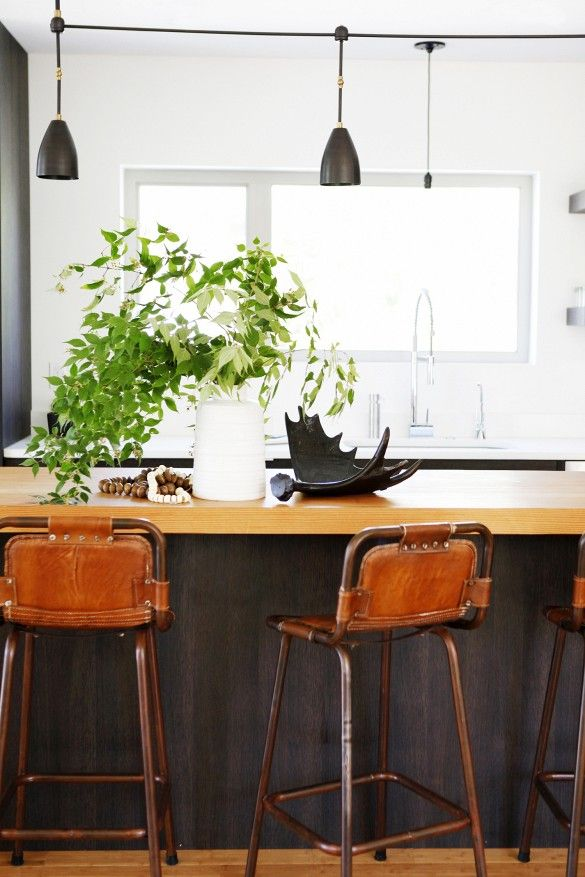 Home Tour: A Perfectly Balanced Creative Seattle Pad//Modern kitchen with Apparatus Studio industrial light fixtures