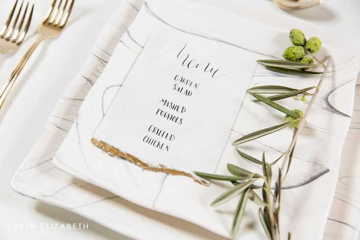 wedding dinner menu calligraphy with gold paint on the bottom, marble square wedding dinner plates
