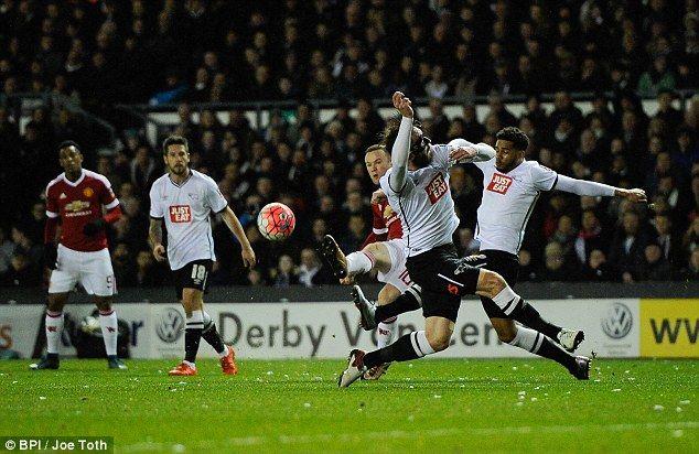 Rooney bent the ball into the top corner beyond Derby goalkeeper Scott Carson...