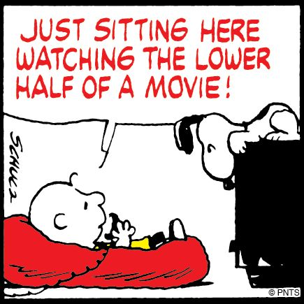 Charlie Brown and Snoopy watch TV.