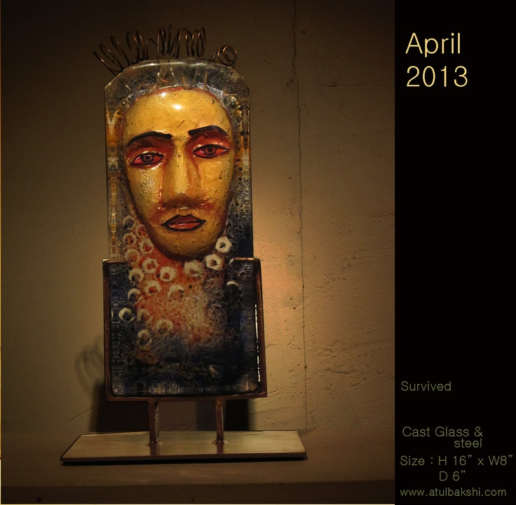 Survived- 3D copper head inserted into hot glass . The glass was then worked on while still hot. Sculpture by Atul Bakshi