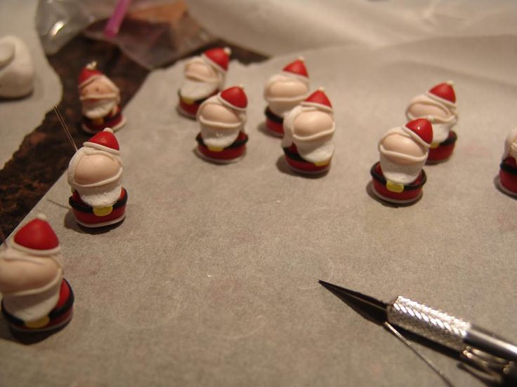 polymer clay army of santa!! https://www.facebook.com/ClayMiniGifts/