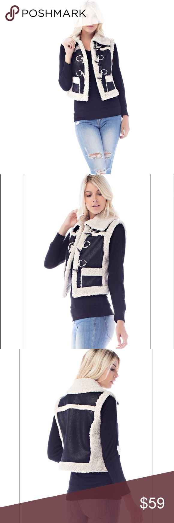 ✨NEW ARRIVAL!! Black & Cream Faux Shearling Vest✨ Adorable and winter chic black & cream faux suede shearling vest! Black soft suede material with soft cream and warm faux shearling! Collared, open front with silver hardware detail on front, crops at waist. Super cute with jeans or black pants and worn over tight fitting sweater or flannel top! Brand new from manufacturer❤️ Boutique Jackets & Coats Vests