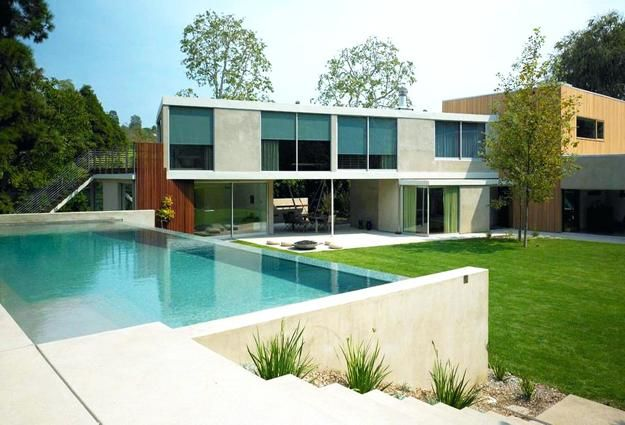 Negative Edge Pool Designs And Spillover Waterfalls Merging With Landscape Modern Exterior Modern Pools Modern Pool And Spa