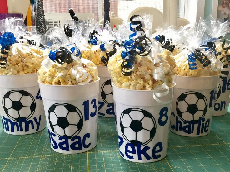 Personalized cups with popcorn for soccer tournament team treat. ⚽️⚽️