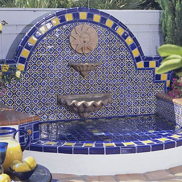 Use our back brick wall to make this type of fountain that pours into the pool once we remove the diving board. Way cool!!   Fountain
