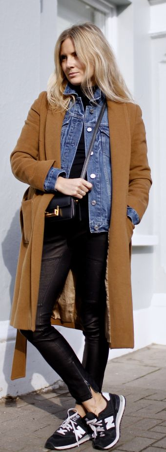 Lucy Williams is wearing a Vestiaire Collective coat, a denim jacket from Gap, J. crew leather pants and New Balance sneakers