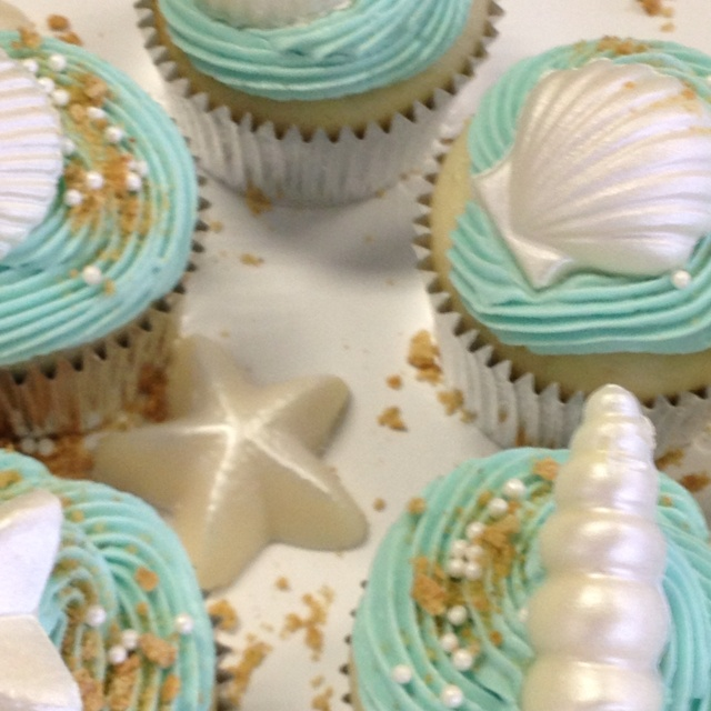 Beach theme cupcakes with white chocolate shells.