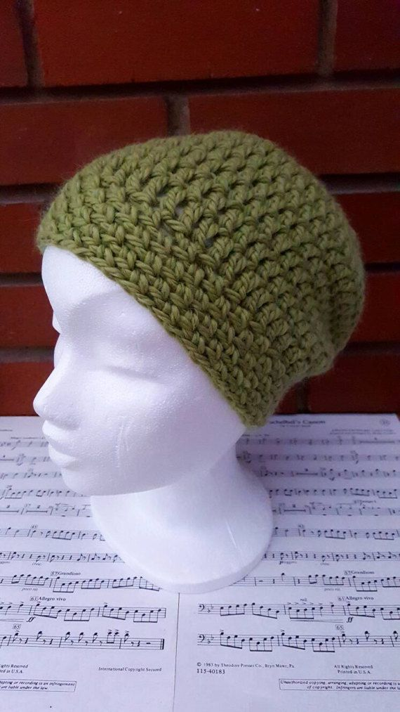 This is a hand crochet hat made in a luxurious wool and alpaca mix yarn. This hat is suitable for an adult,and is incredibly soft. A perfect gift for anyone in your life, or why not treat yourself! The simple crochet beanie design means it this winter hat is suitable for a woman or man. Made from a green chunky yarn and hat washable. This is a ready made item and will be dispatched in 1-3 working days. Made in a smoke and pet free home. Although I try my best to show my products in their…