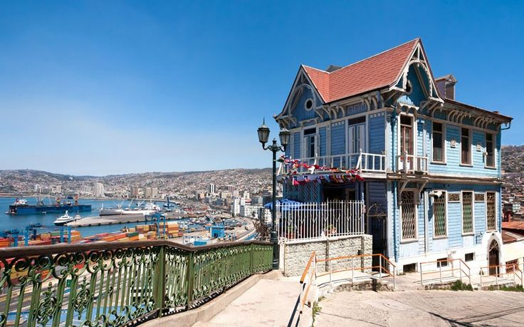 See the colorful houses and beachfront views