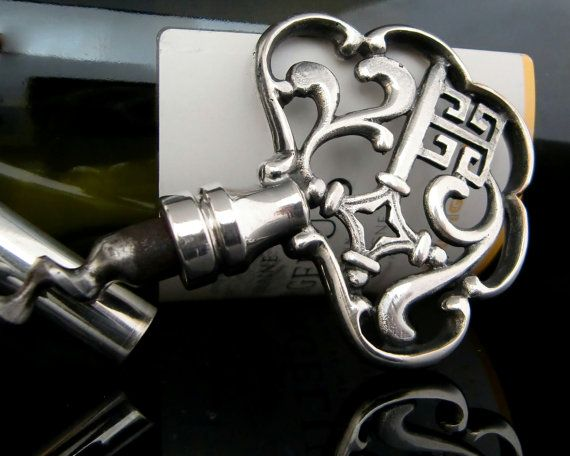 Vintage barware. Silver plated, very stylish key-corkscrew decorated with the Bremer Schlüssel (Bremen Key). Such keys originate from the German