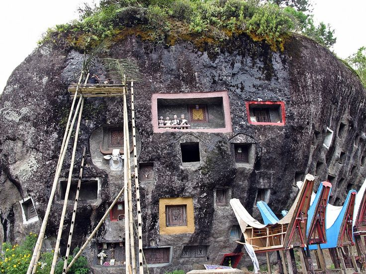 The wealthy are often buried in a stone grave carved out of a rocky cliff. The grave is usually expensive and takes a few months to complete. South Sulawesi, Indonesia