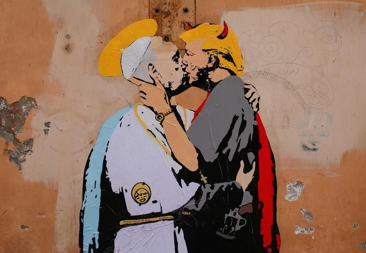 A life-size mural depicting Pope Francis with a saintly halo kissing U.S. President Donald Trump sprouting devil's horns appeared on a wall near the Vatican on Thursday, less than two weeks before they are due to meet.
