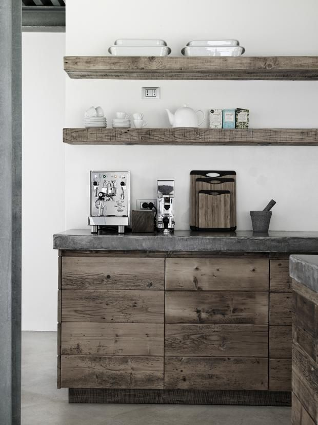 Polished concrete floors and work-top. Rustic, linear cabinets, chunky shelves. Indoors and out.