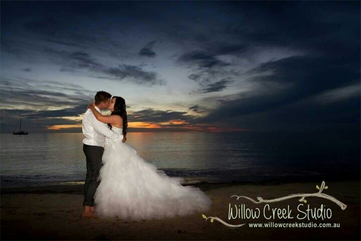 We love this magnificent beach sunset wedding photo by Willow Creek Studio