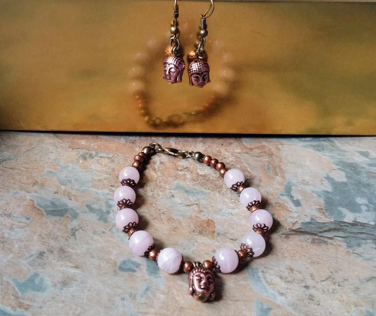 Rose quartz and cooper bead Buddah bracelet and matching copper Budda earrings by SpryHandcrafted on Etsy