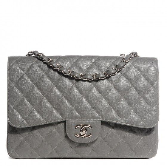 This is an authentic CHANEL Caviar Quilted Jumbo Single Flap in Grey. This stylish shoulder bag is crafted of luxuriously textured padded diamond quilted caviar grey leather.