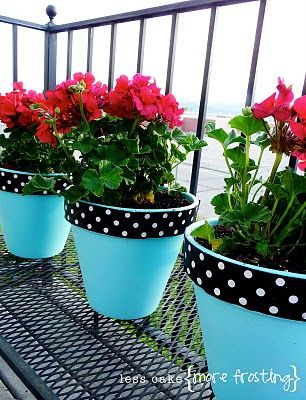 Painted terra cotta pots (in wedding colors) with flowers as centerpieces.                                                                                                                                                                                 More