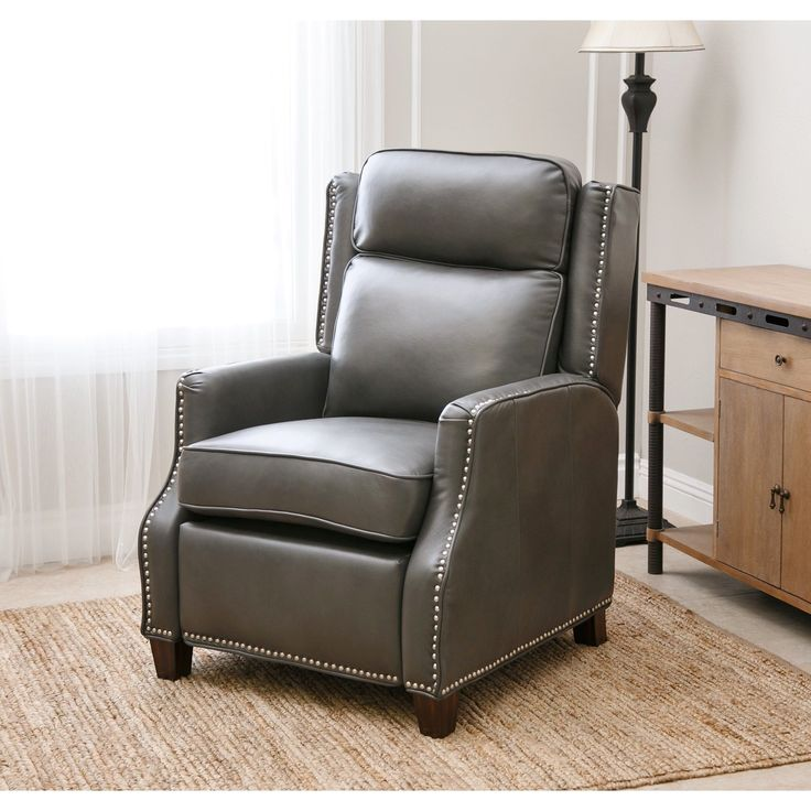 As an economic alternative to natural leather, this leather gel upholstered recliner chair is every bit as elegant and richly smooth to the touch as the real thing. The sleek sheen of grey color and t
