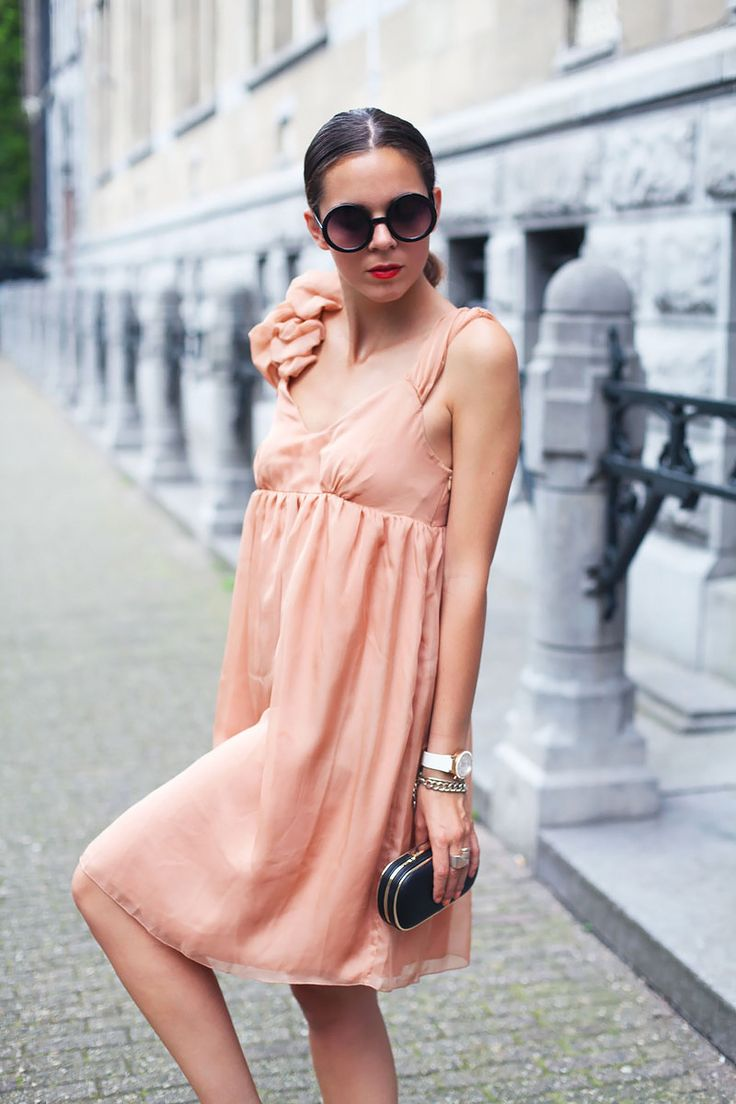 I've dressed up this simple dress with black high heels, an evening clutch bag, red lipstick and a chic up-do, but this dress also looks great with strappy sandals and a floppy straw hat for the beach!