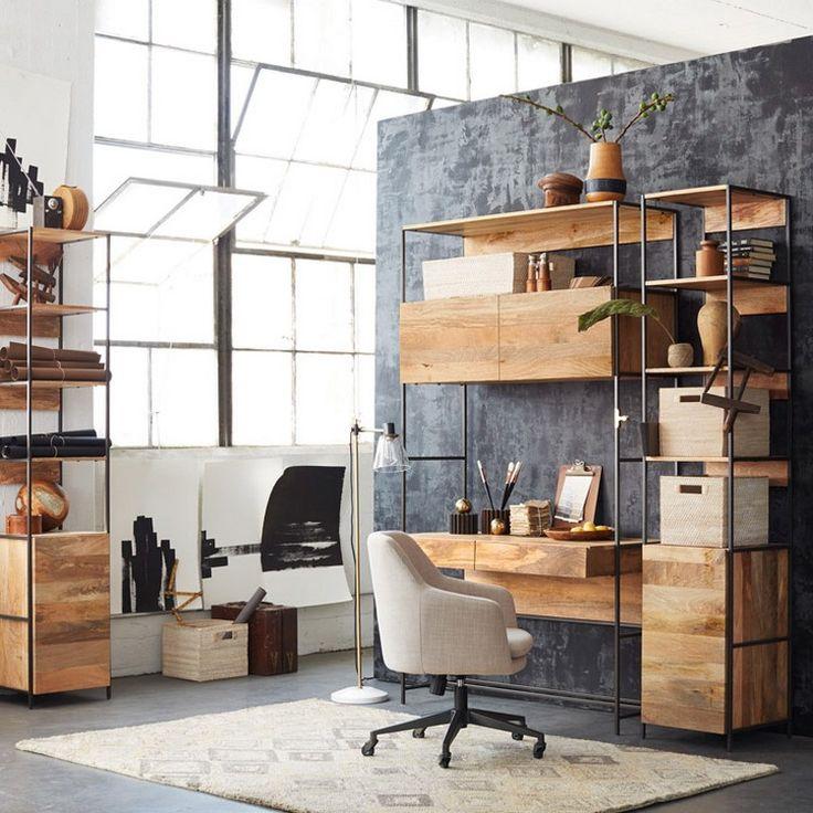 bureau suspendu en bois massif, tapis graphique, sol en béton ciré et plantes vertes