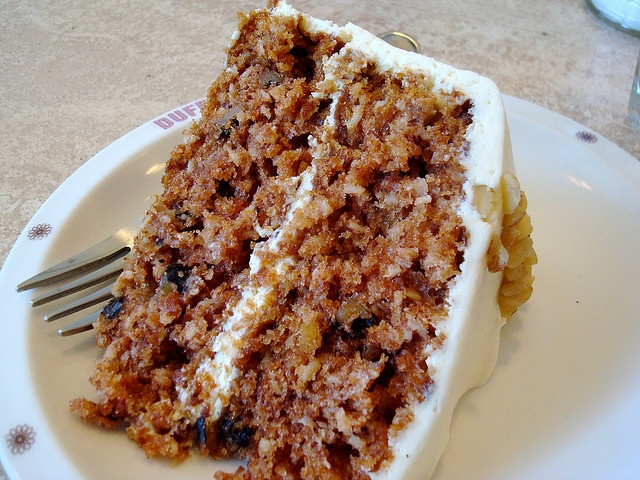 Dufflets does it right.  Carrot cake with cream cheese icing