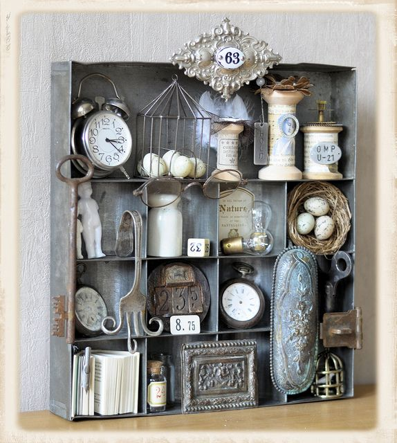 old vintage tin shadowbox box filled with pieces from the past