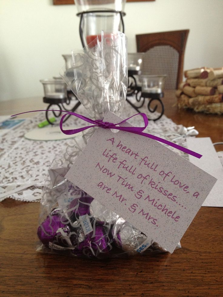 My wedding colors were purple and silver do I used dark and milk chocolate kisses as favors.