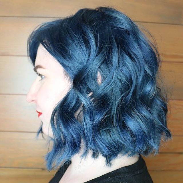 Blue Aveda Color is an unexpected (and very cool) choice for a wavy bob. Work by Aveda Artist @michelle_senour.