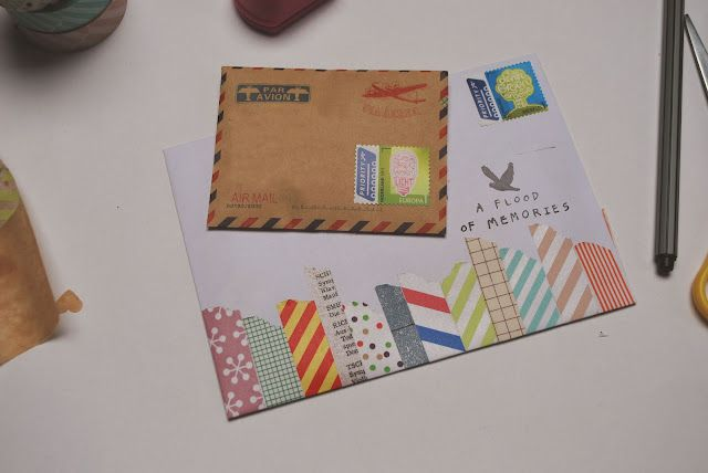 snail mail.. cute idea, washi tape or glue random paper strips on bottom of envelope