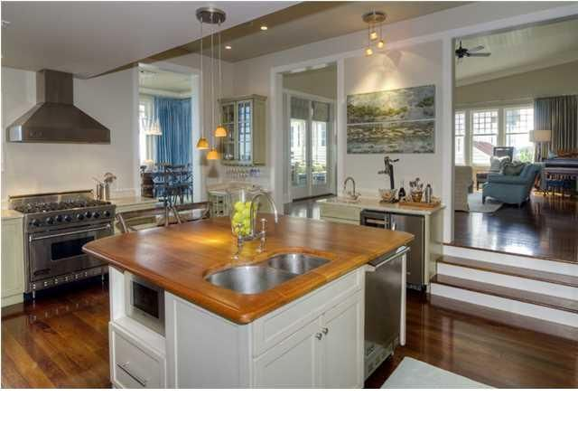 viking refrigerator inside. the island is home to a double basin sink, stainless steel viking dishwasher \u0026 microwave refrigerator inside