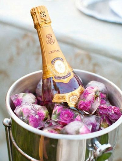 Flower ice cubes...purpose and decore  Would look even better on a transparent ice bucket!!!